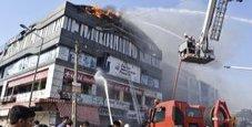 Immagine Salto nel vuoto dall'edificio in fiamme, 19 morti