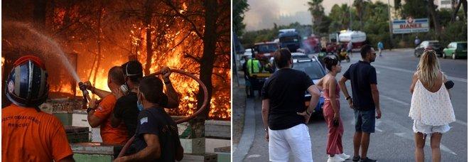 Atene, gli incendi arrivano in città: gente in fuga dalle abitazioni