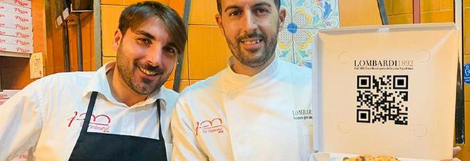 Enrico e Carlo Alberto Lombardi mostrano una pizza con il code - QR