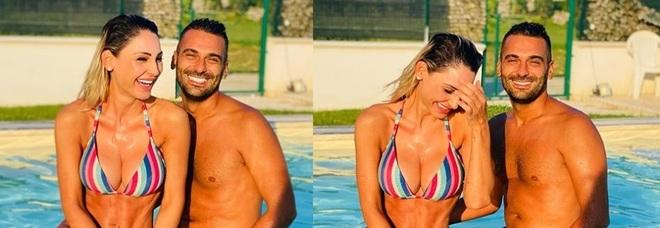 Anna Tatangelo in piscina con un uomo misterioso, fan in delirio: «Siete bellissimi». Ma c'è un particolare