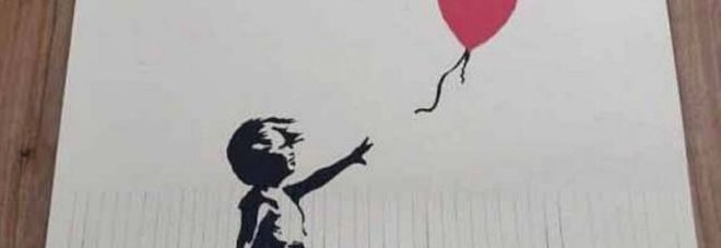 Fa a striscioline stampa di Banksy da 40mila sterline per aumentarne il valore: ora vale un pound