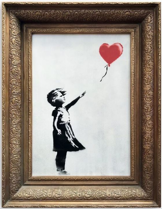 La beffa dell'artista: 'Girl with balloon' di Banksy si autodistrugge ad un'asta